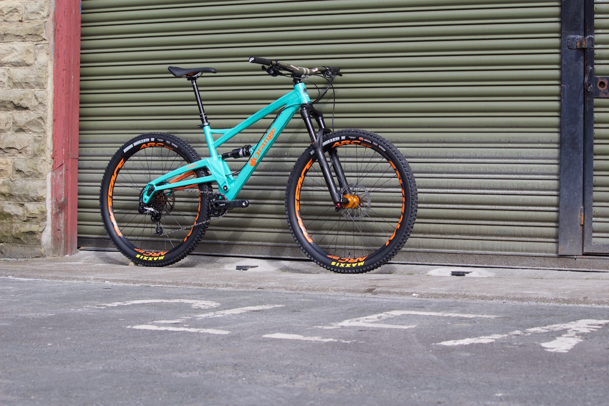 orange four full suspension trail bike